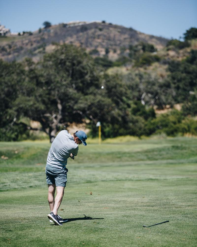Derek golfing